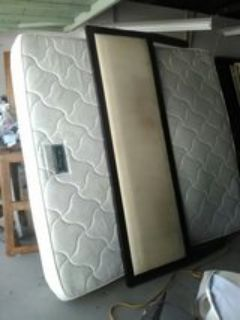 cal- king bed with wooden headboard and frame