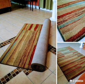 8x5 thick and heavy area rug. In good condition.