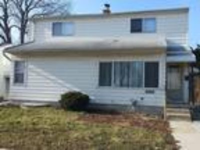 Spacious Four BR home with 1 1/Two BA. Large eat-in kitchen and full basement