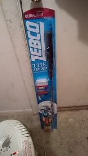 Zebco ultralight fishing pole and tackle box