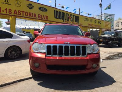2009 Jeep Grand Cherokee Limited (Red Rock Crystal Pearl)