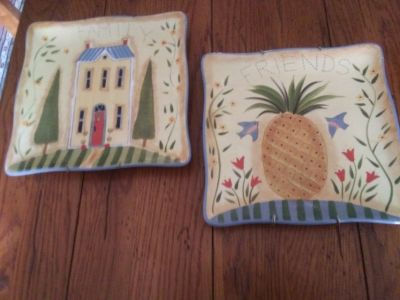 Hanging plates with one pineapple hospitality and the other home sweet home image