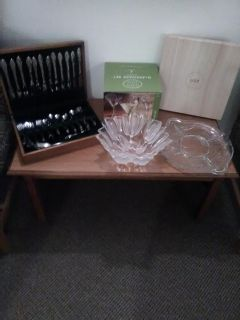 Beautiful serving glass and wooden cheese trays, flatware, & cocktail glasses