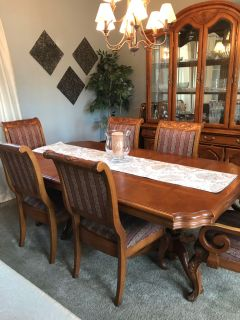 China cabinet and table with eight chairs