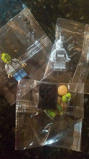 New in package. Set of 3 Zombies Lego figures, 2 men, 1 woman. All for $3