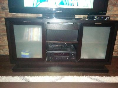 $360, Model home moving sale Dark wood TV console, frosted glass cabinets