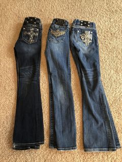 Girls size 12 Miss Me Jeans. $20 each or $50 for all. 2 bootcut and 1 skinny