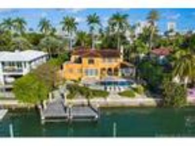 Carl Fisher Real Estate For Sale - Six BR, Five BA Mediterranean - Waterfront -