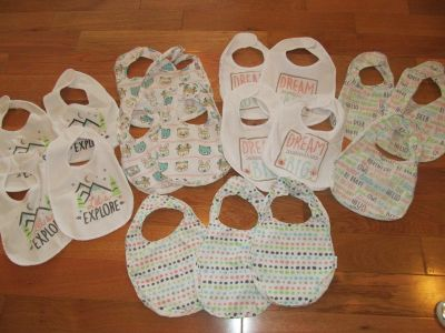 Large lot of 18 coordinating bibs