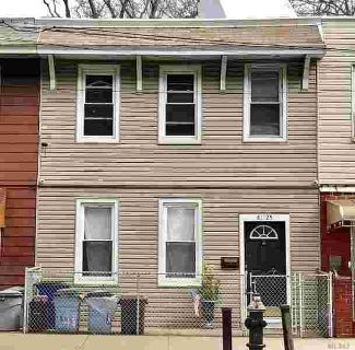 81-25 Liberty Ave Ozone Park Four BR, Cozy 2 family home.