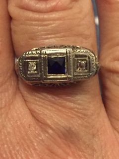 Antique filigre ring with diamonds and blue sapphire