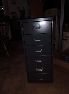 Gray metal 6 drawer unit with wheels