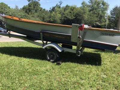 14 Wooden Boat 25 HP Johnson motor and trailer