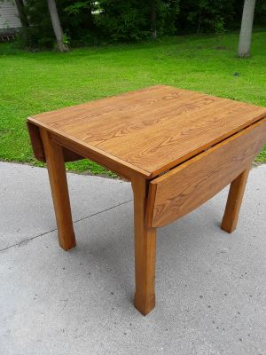 Solid Oak drop side kitchen table .