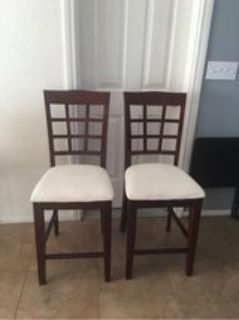 2 brown chairs with cream seat