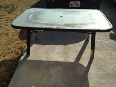 Free patio table by curb (9908 Fantail Ln)