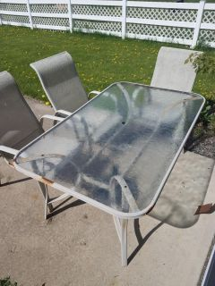 Outdoor glass table and 5 chairs