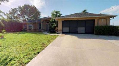 1822 NE 11th LN Cape Coral Four BR, Beautiful Pool Home in NE .