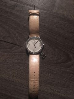 Pink watch with breast cancer symbol