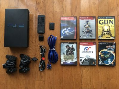 PlayStation 2 original console with 2 controllers, wireless remote, 8GB memory card, MONSTER CAB...