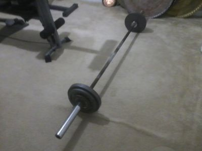 Olympic Bar with 70lbs of weight