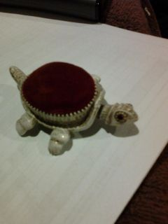 Very old Florenza bobble head and tail turtle pin cushion with red gemstone? eyes