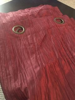 2 long panels of red curtains