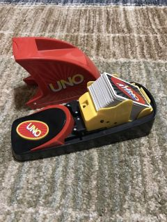 Uno Attack game. Super fun family game. Has speaker function that plays through the game with you. Don't have instructions. Can get online.