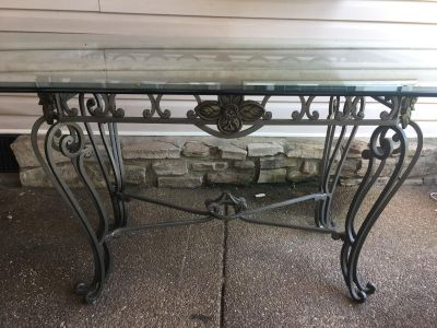 Metal table with heavy beveled glass top and six metal chairs
