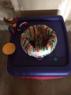 Blue and red child seat bouncer