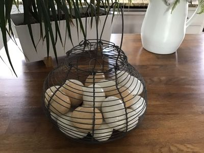 Farmhouse style Porcelain eggs in a wire basket