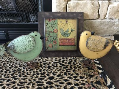 Metal plaque and two metal birds
