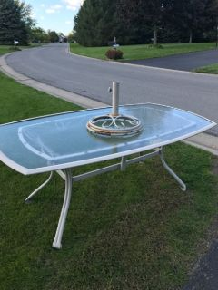 Glass top patio table and base.At curb 1506 Chigwell La N Webster. Off Phillips