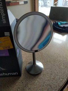 Simply human makeup mirror with rechargeable cord