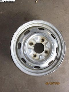 vw four lug chromed wheel