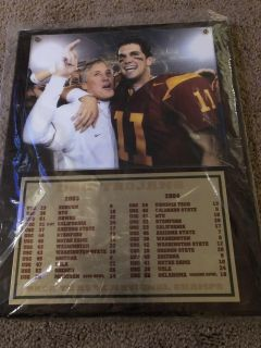 PLAQUE COMMEMORATING THE 2003-2004 USC TROJANS BACK-TO-BACK NATIONAL CHAMPIONS
