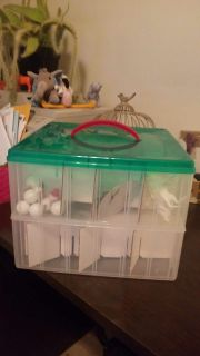 2 layer containers with removable dividers. Can be used to store ornaments