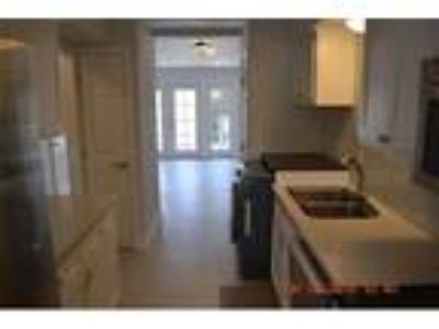 Real Estate Rental - Two BR 1 1/Two BA Townhouse Apartment