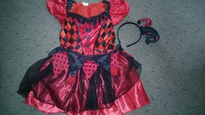 Harley quinn costume 4-6 over all great condition just missing couple poms off skirt part