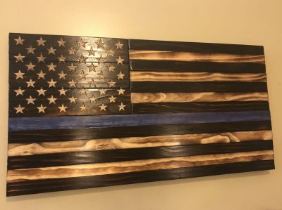Wooden American flag with hand carved stars