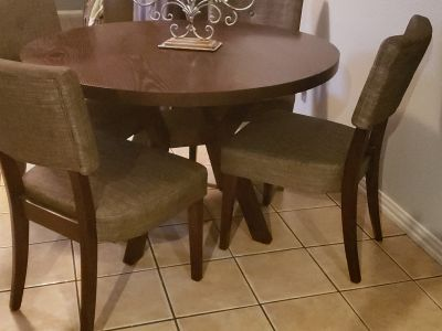 At home dinning table and 4 chairs poms