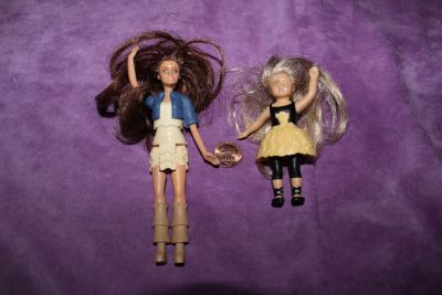 Two Small Movable Dolls. One is American Girl $1