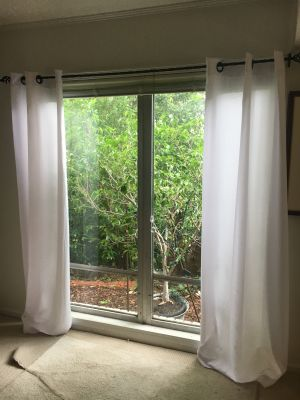 6 white poly/linen blend curtain panels plus 3 decorative 90 twisted black wrought iron curtain rods