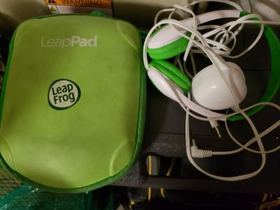 Leapfrog with case, headphones, and power cord