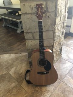 Acoustic guitar and carrying case