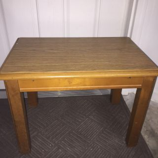 24 x16 and 17.5 tall table in good condition. Wood with laminate top. No water damage. Edges are a little worn. Great project piece/as is