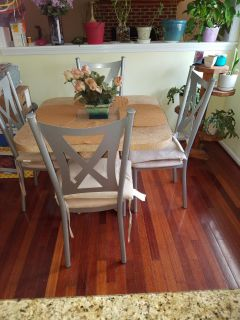 Table set solid formica table and pedestal all one piece. Four chairs.
