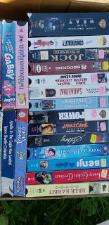 Two boxes of VHS movies. 36 movies total.