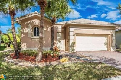 Stunning 4/3 home with 2 car garage in prestigious community.