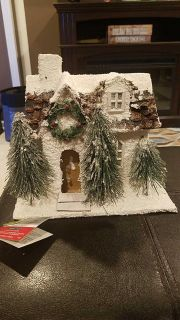 New with tags. Decorative paper mache Christmas house